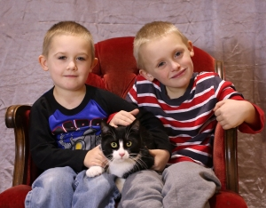 two-boys-with-their-cat